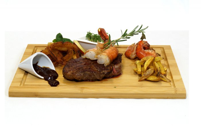 """SURF & TURF"" Rib Eye Steak vom Black Angus mit Riesengarnelen"